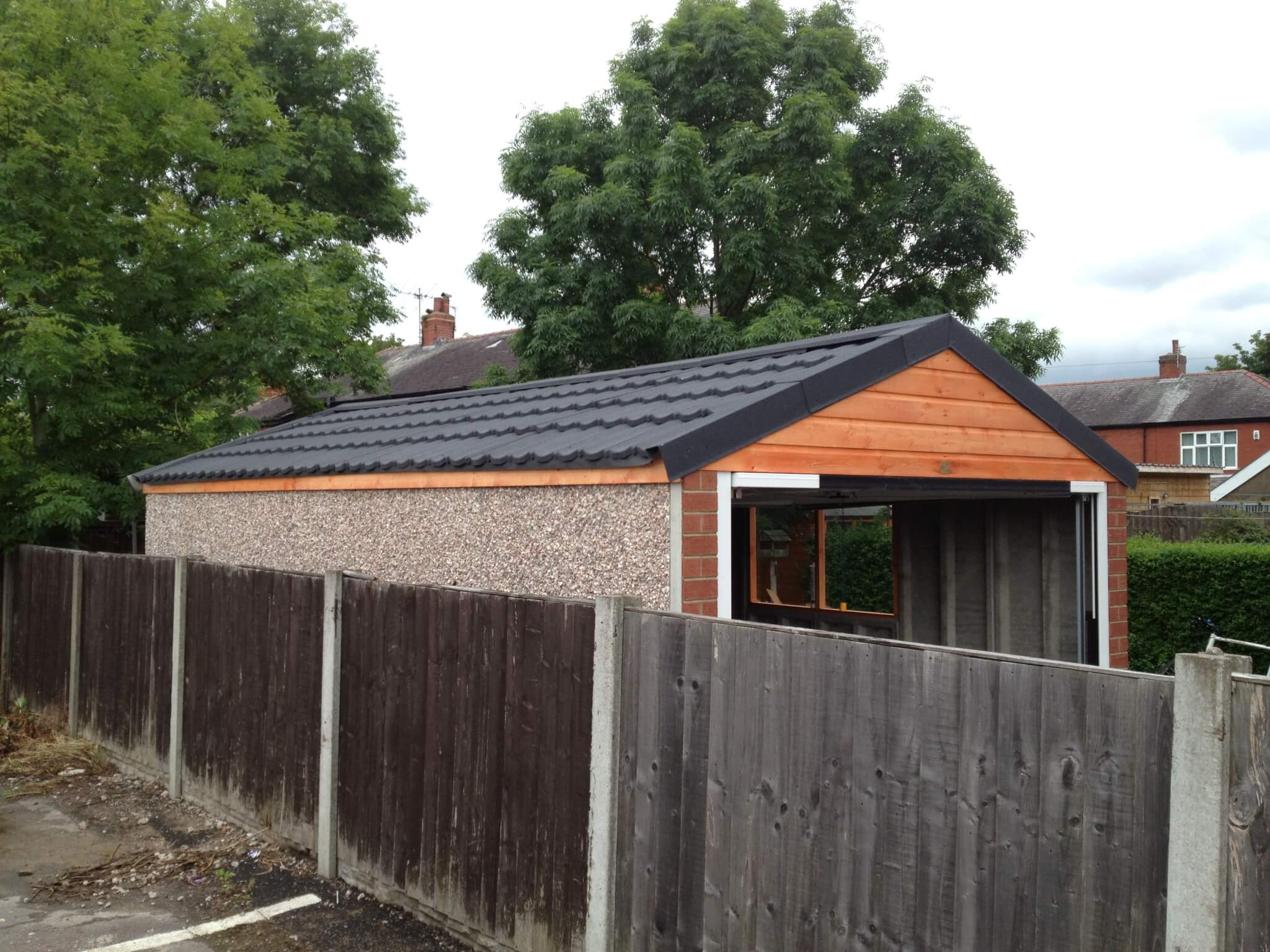 domestic garage with slate roof