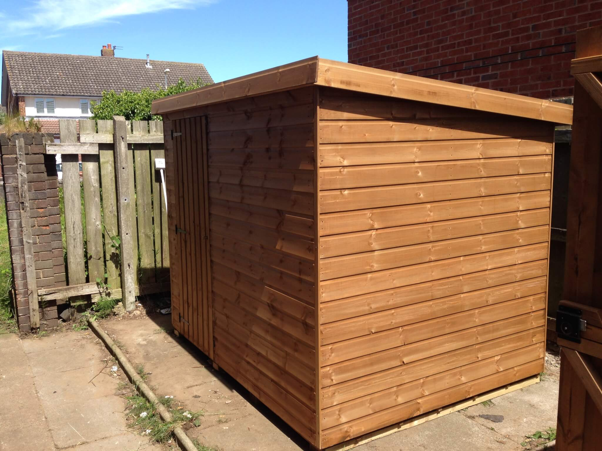 small garden timber shed with door