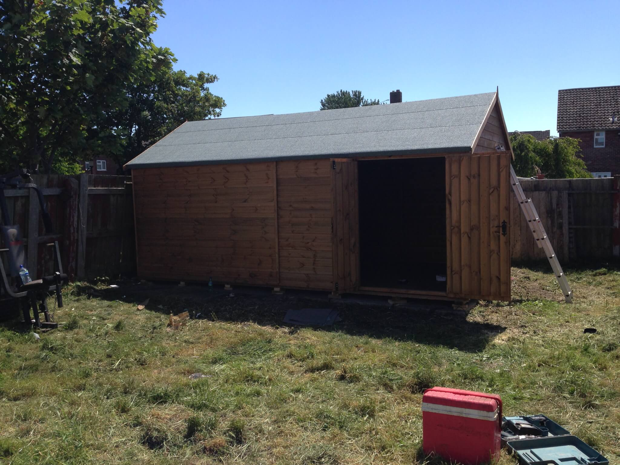 large timber shed with felt roof
