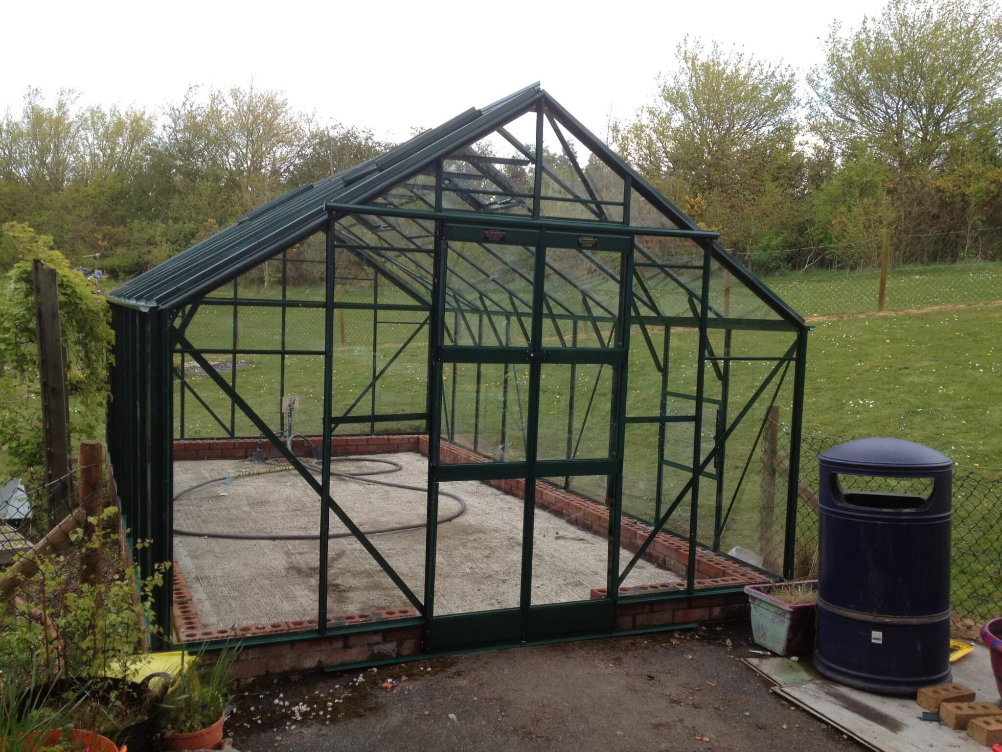 front of large greenhouse